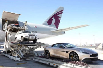 the worker loading the car to the plane