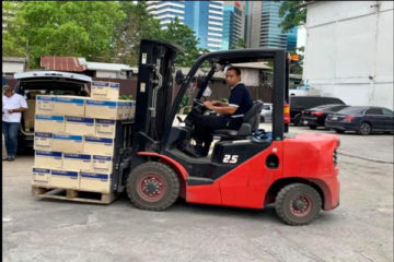 the worker moving the parcel by forklift