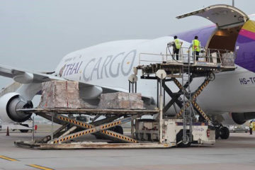 the worker loading the parcel to the plane-7
