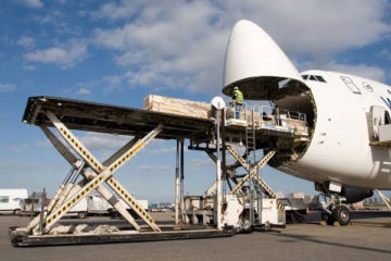 the worker loading the parcel to the plane-6